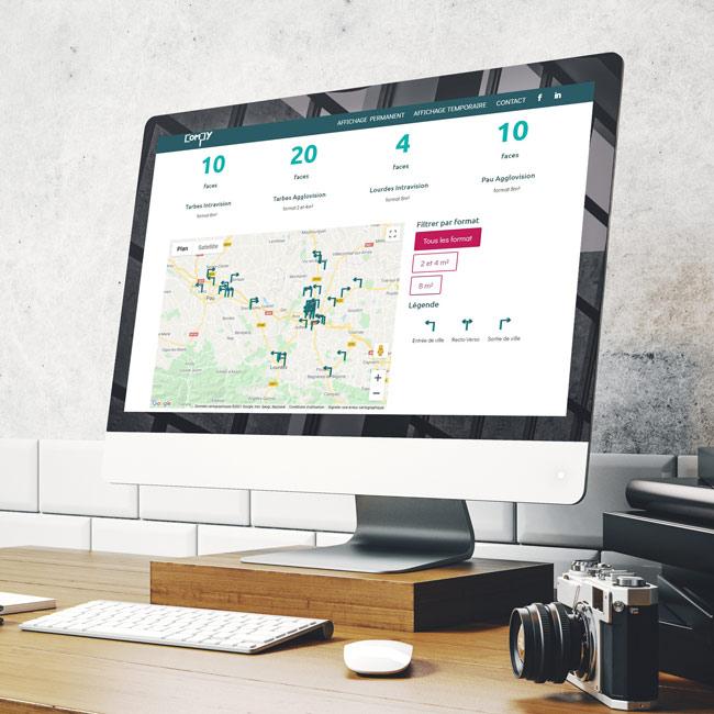 Ordinateur présentant le site internet de compy, affichage dynamique